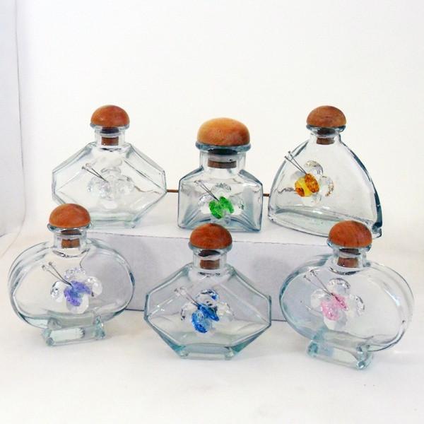 Barattoli in vetro con farfalle assortite in cristallo brillante