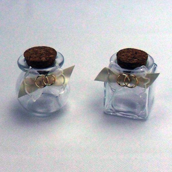 Barattolo in vetro con fedi dorate e tappo in sughero