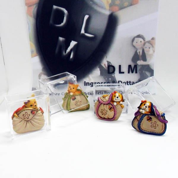 Scatoline con calamite  in resina, a forma di borsetta e animali